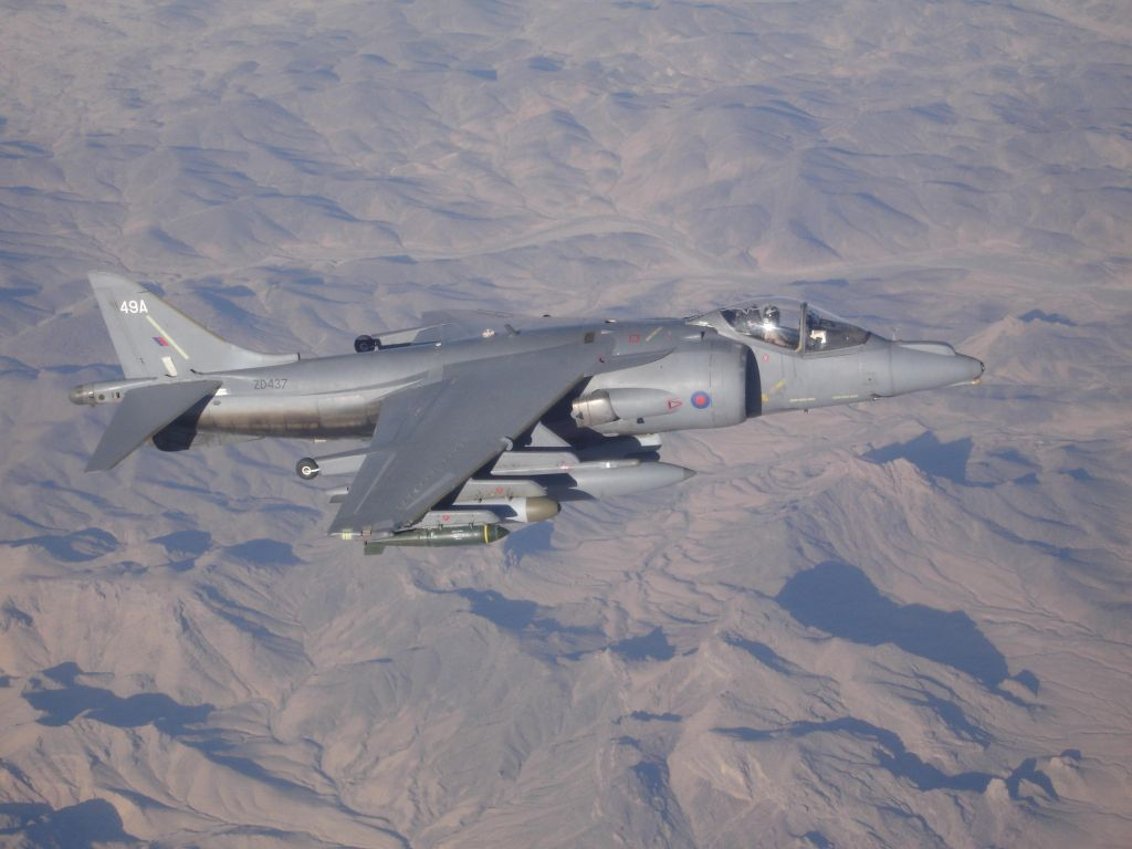 Joint Force Harrier Aircraft flying over Afghanistan mountains