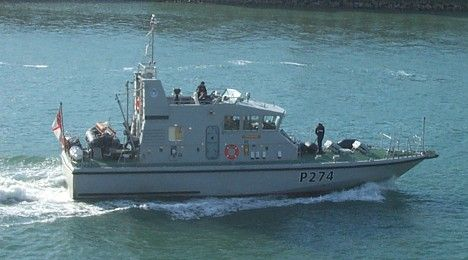 HMS Tracker entering Portsmouth on 7 October 2004