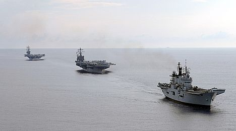 HMS Illustrious leading USS Harry S. Truman and USS Dwight D. Eisenhower