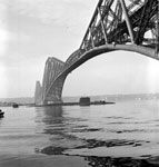 HMS Resolution going under the Forth Bridge