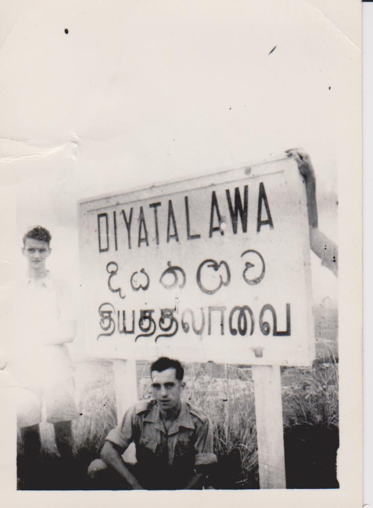 My dad, Don Green in front of a sign in Sri Lanka
