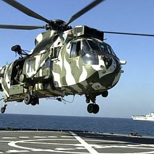 RN Sea King from HMS Illustrious landing on USNS Pecos 23 Feb 2002